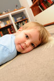 Girl lying on the floor Royalty Free Stock Image