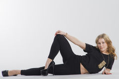 A girl lying on the floor Royalty Free Stock Image