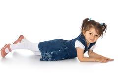 Girl lying on the floor Stock Photography