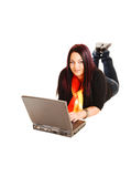Girl lying on floor with laptop. Stock Image