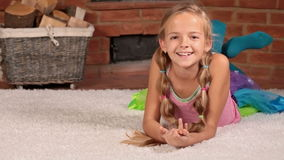 Girl lying on the floor laughing with joy stock footage