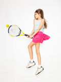 Girl lying on floor and pretending to play tennis Royalty Free Stock Photos