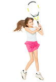 Girl lying on floor and pretending to play tennis Stock Image