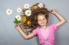 Girl lying with flowers in her hair Royalty Free Stock Images