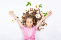 Girl lying with flowers in her hair Stock Photo