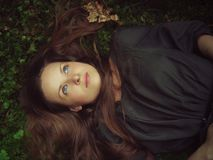 Girl lying in forest Stock Photos