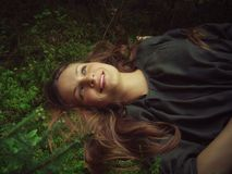 Girl lying in forest Stock Image