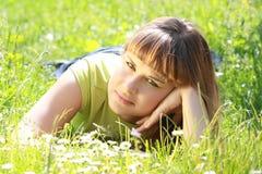 Girl lying in the garden Stock Photos