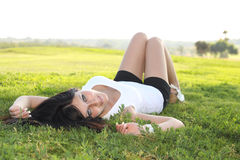 Girl lying on a grass. Nice woman lying on a grass in a sunny day stock photo