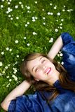 Girl lying on the grass Stock Images
