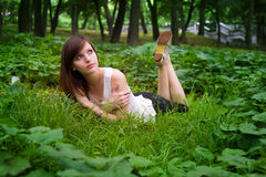 Girl lying on the grass Royalty Free Stock Image