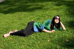 Girl lying on grass Stock Image