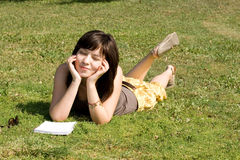 Girl lying on grass Royalty Free Stock Photography