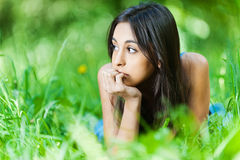 Girl lying grass Stock Photo