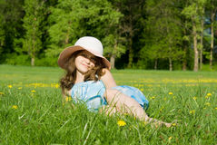 Girl lying on grass Stock Images