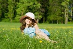 Girl lying on grass Stock Images