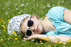 Girl lying on grass Royalty Free Stock Images