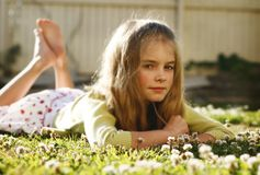 Girl lying in grass Royalty Free Stock Photography