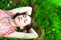 Girl lying on grass Stock Photography