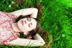 Girl lying on grass stock photography