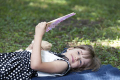 Girl lying on the grass and cools the Stock Photo