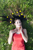 Girl lying on the grass flatten your hair Stock Photo