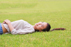 Girl lying in the grass Stock Photos