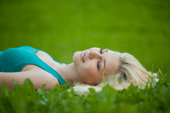 Girl lying on the grass and sleeping peacefully Royalty Free Stock Photography