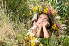 Girl lying on grass and smiling Royalty Free Stock Photo