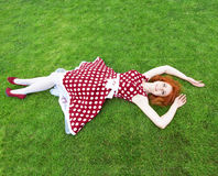 Girl lying on the grass Stock Photo