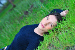 Girl lying on the grass Stock Photos