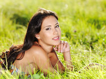 Girl lying on the green grass Royalty Free Stock Photos