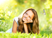 Girl Lying on Green Grass Stock Image