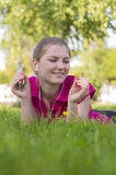 Girl lying on green grass Stock Images