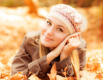 Girl lying on the ground Stock Image