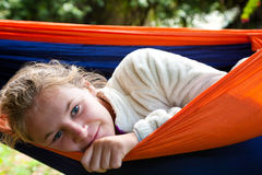Girl lying in hammock Royalty Free Stock Image