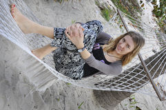 Girl lying in a hammock. Royalty Free Stock Images