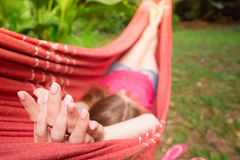 Girl lying at the hammock Stock Images