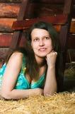 Girl lying on hay Stock Image