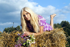 Girl lying on a haystack Stock Image