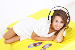 girl lying in the headphones Stock Photography