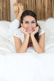 Girl lying on her bed Stock Photo