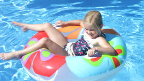 Girl lying on inflatable rubber  stock video