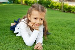 Girl lying on the lawn Stock Images