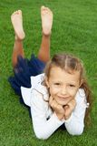 Girl lying on the lawn Royalty Free Stock Photography