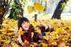 Girl lying in leaves. Royalty Free Stock Photos