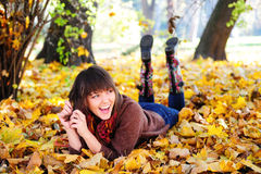 Girl lying in leaves. Royalty Free Stock Photo