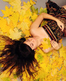 Girl lying in leaves. Stock Images