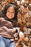 Girl lying in leaves Royalty Free Stock Photo