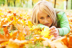Girl lying in leaves Stock Photos